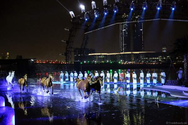 Horses galloping across the submerged stage at UAE 44th National Day 2015 in Dubai, a performance trained from Bedouin horseman - Ali Al Ameri - the horsemaster